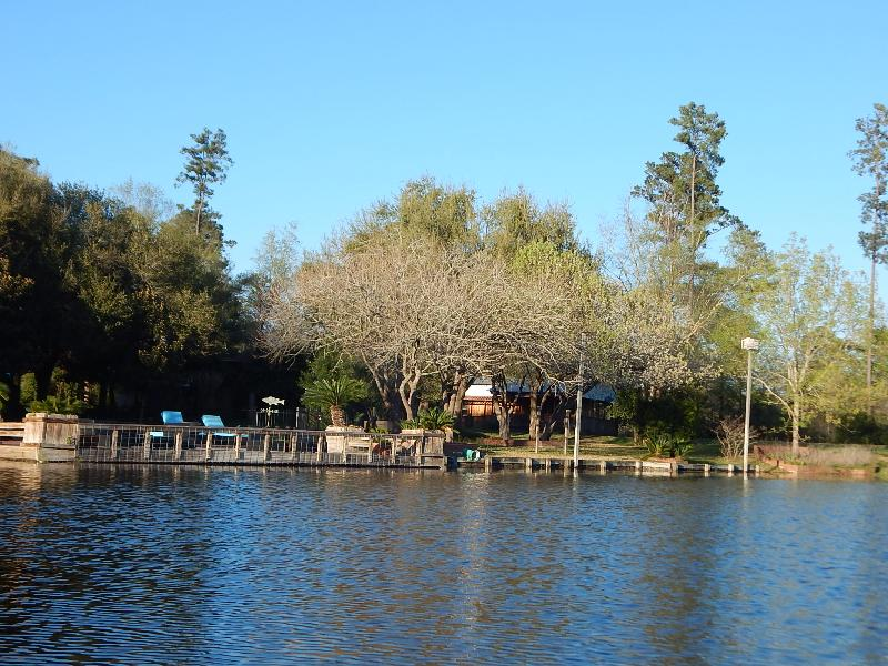The Bar B Bungalow is secluded behind the trees but overlooks the private 6.5 acre lake