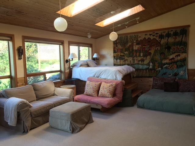 Larger of the two bedrooms.; featuring two beds, down comforters, sitting area with tv.