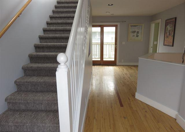 Second floor open area-screened in porch through double doors.  Stairs to third floor.