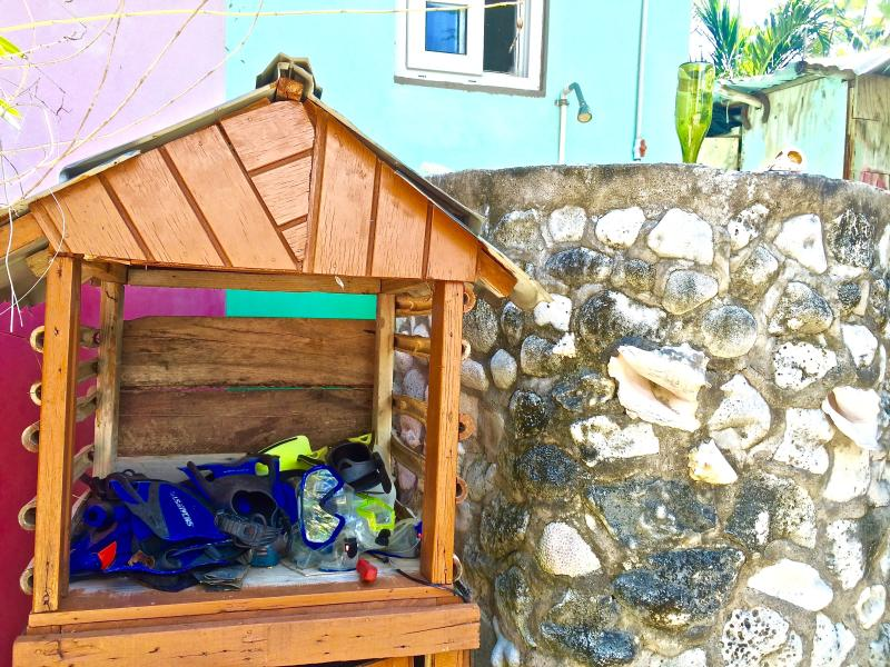 We have it all at Coral Cottage Jamaica! Snorkel gear and an outdoor shower!