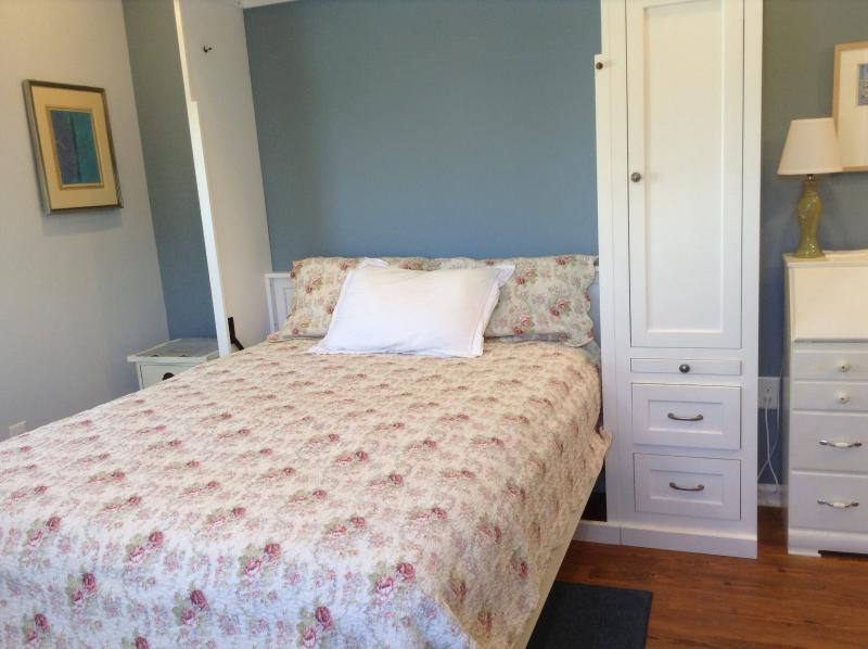 Beautiful custom bed with 12'  Queen mattress. New studio apt. with kitchenette/tile bath.