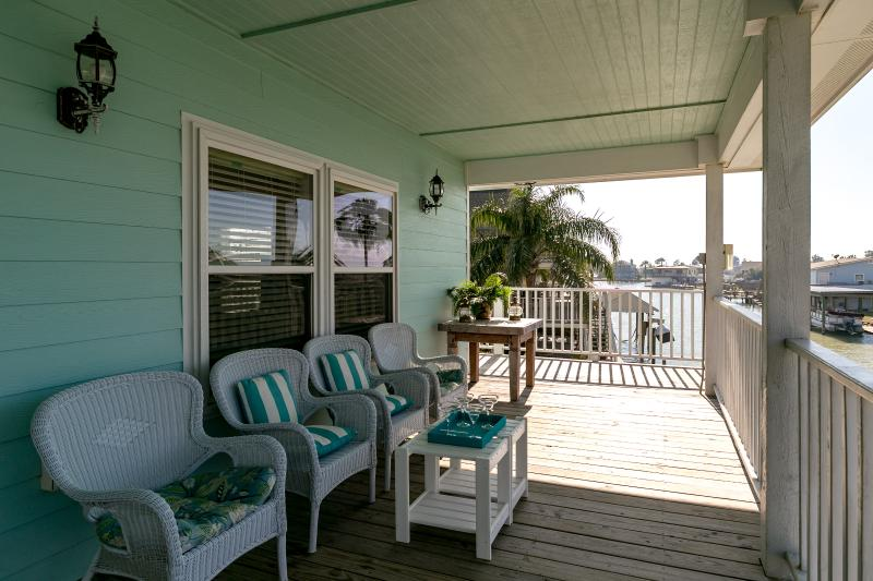 Spacious balcony with very nice out door furniture to sit and relax and enjoy the views.