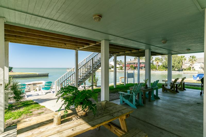 Downstairs covered area is a great place to gather and bbq or just sit and enjoy the great breezes.