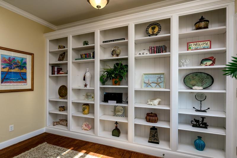 As you enter this beautiful custom built bookshelf with coastal decor.