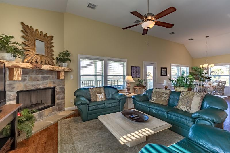 Fabulous living room with stone fireplace. Also has flat screen TV.