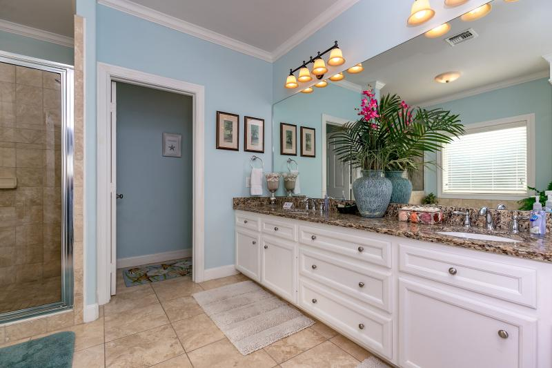 Master bath with granite counter tops and double vanities.