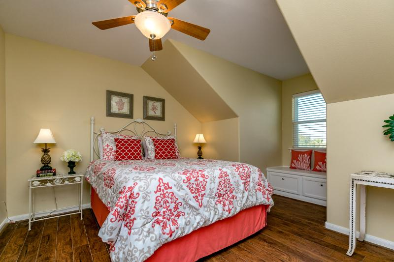 Upstairs guest bedroom #3 with comfy queen bed and beautiful decor.