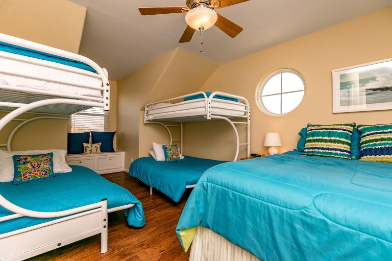 Bedroom #4 with a comfy queen bed and 2 full size bunk beds. Very pretty decor.