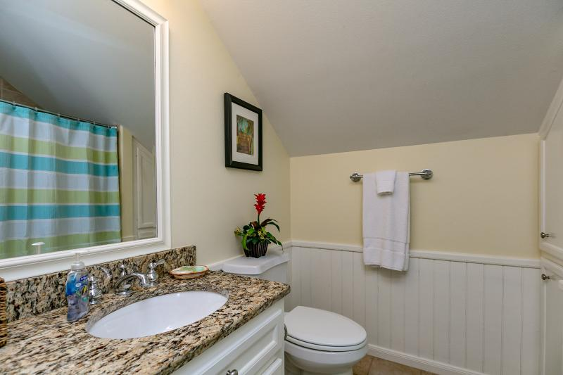 Upstairs full bath has granite counter shower and bath tub.