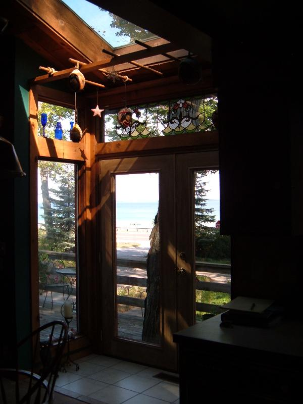 sky light over french doors leading to front deck