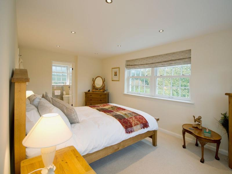 Master bedroom with beautiful outlook onto woods and horses in fields