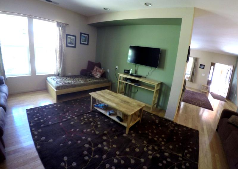 Den with TV and seating for 7.