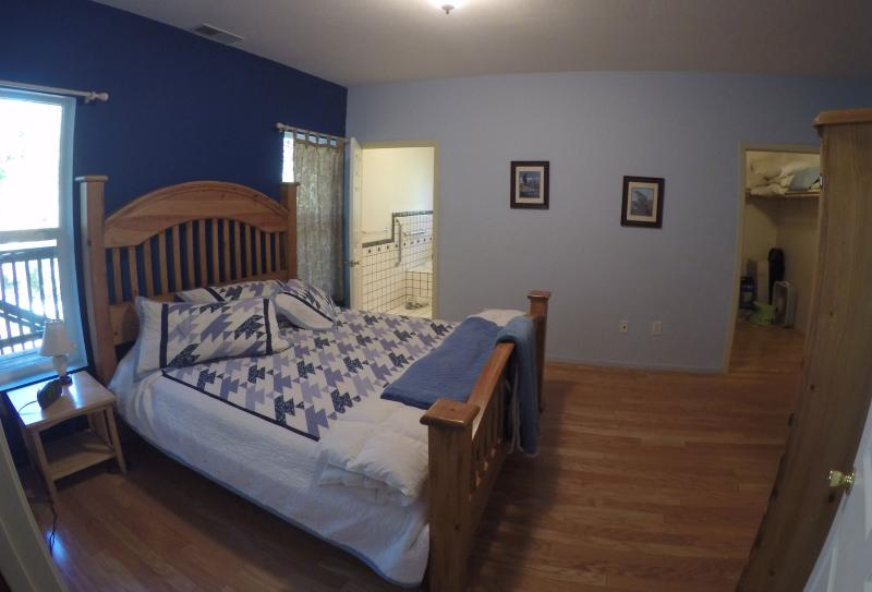 Master bedroom 2--another angle. Baby strollers, high chairs, stair gates, pack-n-plays in closet.