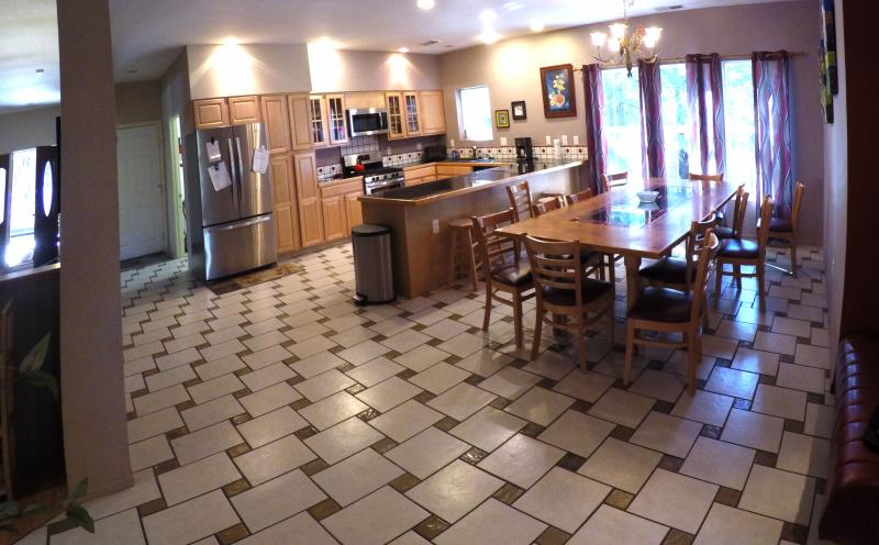 Kitchen and Dining room. Table seats 12 and there is room for a folding table for larger groups.