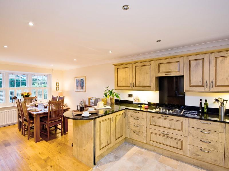 Breakfast bar and oak-floored dining area