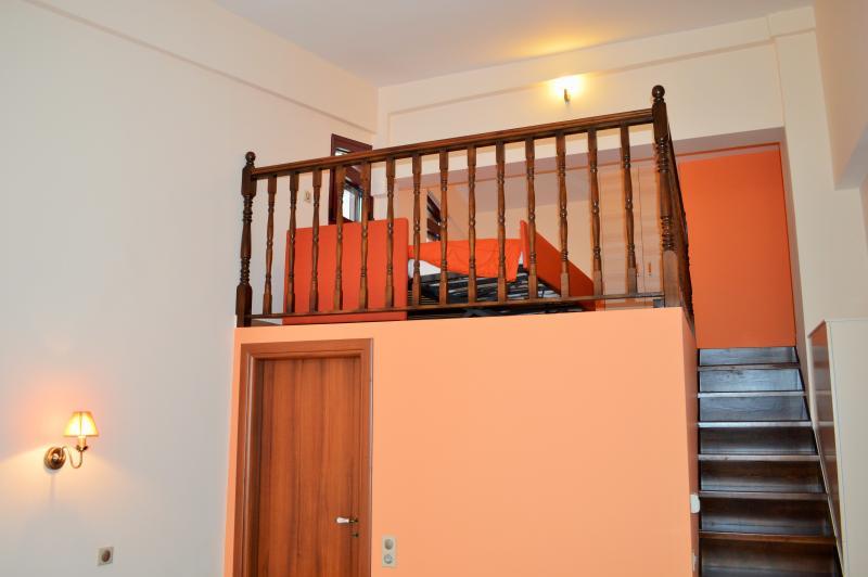Orange Family Room's Side Balcony View