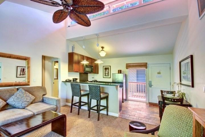 Spacious living room with air conditioning and ceiling fans.