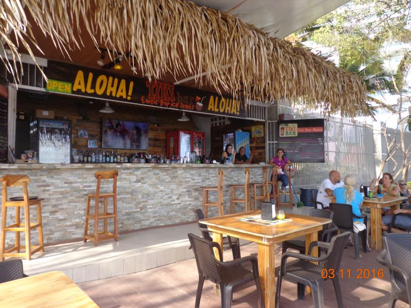 Walk the beach and stop at The Beach Tiki Bar
