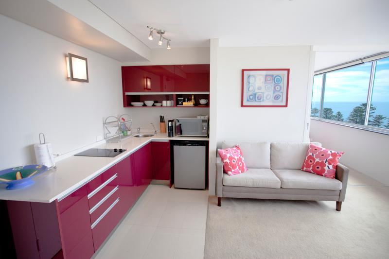 Kitchen corner and living area separated from bedroom by a sliding door