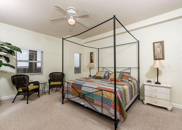 The master suite features a comfortable king size bed, flat-scre