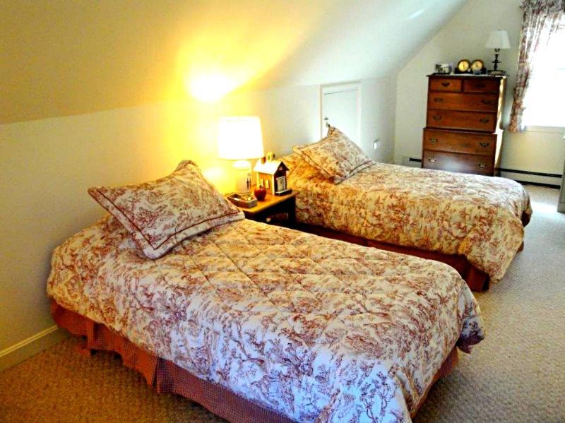 Bedroom with twins over garage