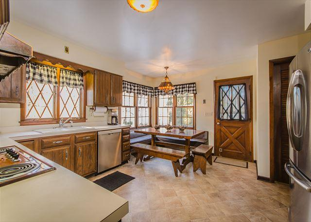 Kitchen adorned with beautiful woodwork, and original diamond st