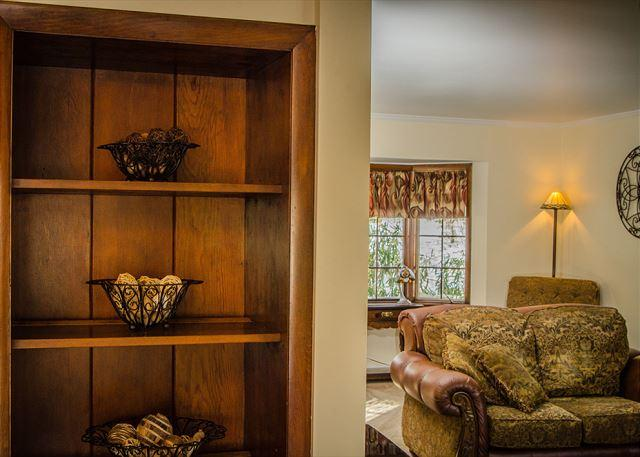 Elegant Wood Shelving in the dining area.