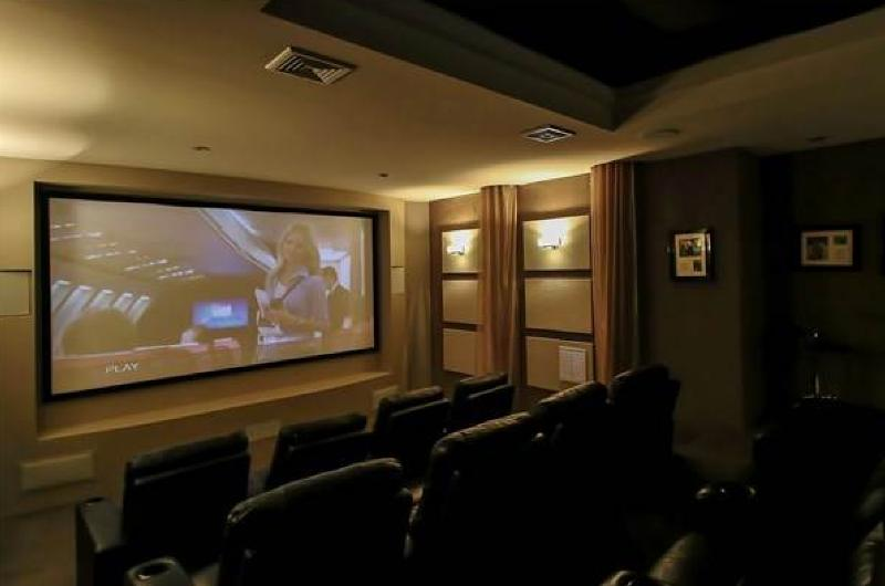 12 Seat Private Theater, Sound Proof. 150 inch Screen. 100 + Private Titles