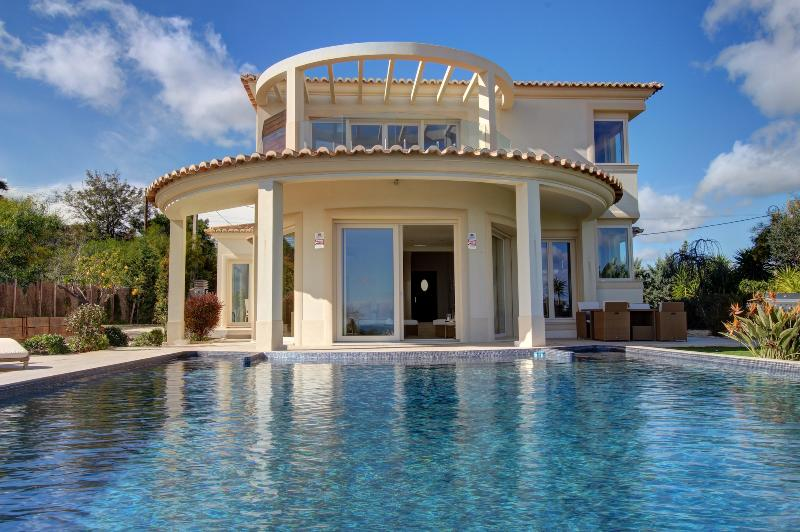 The infinity pool is oversized and expansive