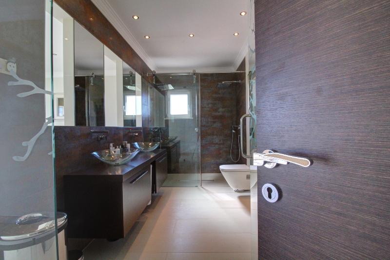 Master bedroom double sink, double rainfall shower head ensuite bathroom.