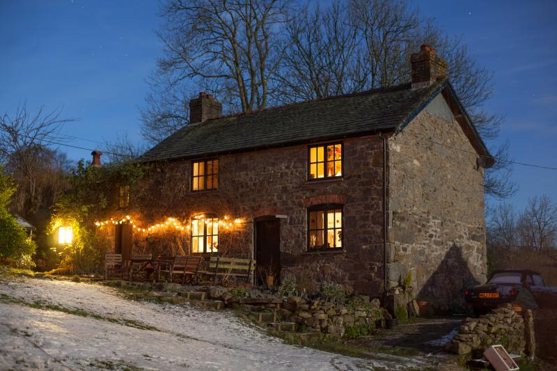 The Farmhouse on a snowy New Year's eve, with a starry starry sky, thanks to our truly Dark Skies