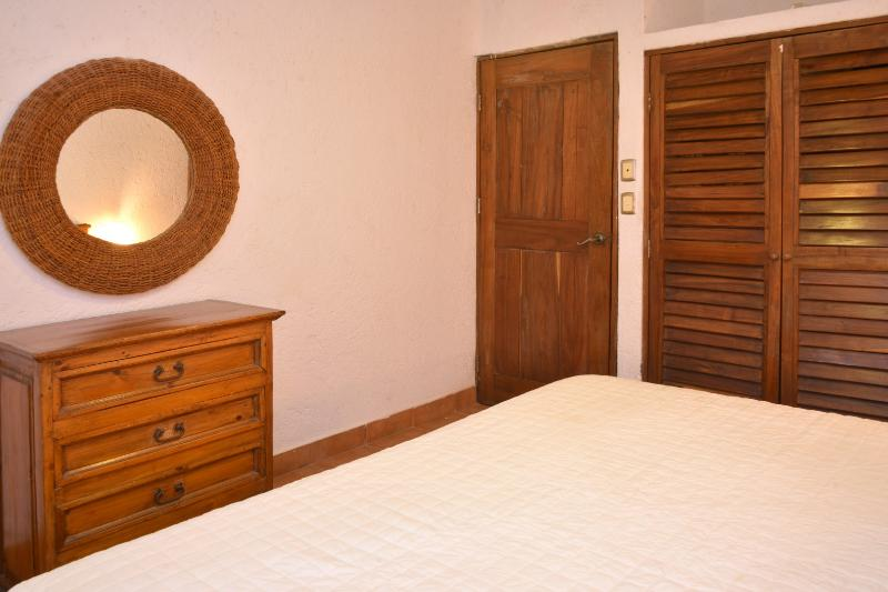 master bedroom with dresser and plenty of closet space