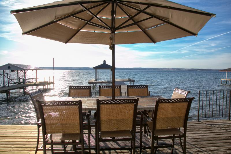 Large covered hightop seats 8! Enjoy lunch & dinner right at the water's edge!