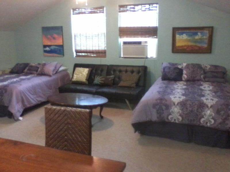 Studio Loft 750 sq feet with two double beds, seated living area combo. full bathroom + dining
