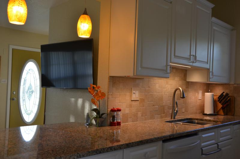 Kitchen with 55' wall-mounted TV in background
