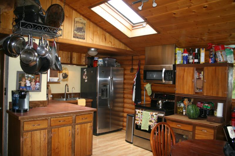 Enjoy our cozy kitchen or go out and cook on the grill