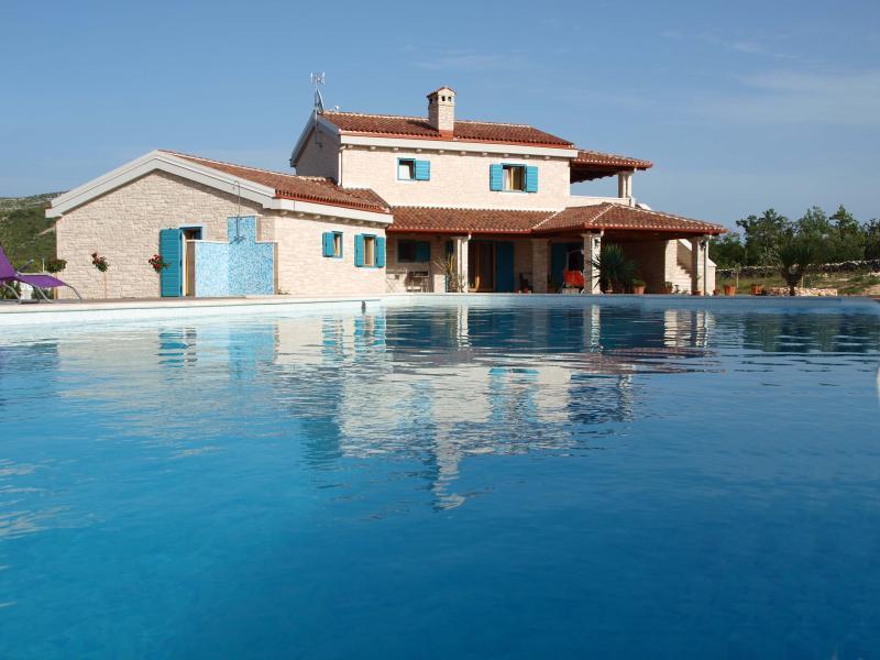 Villa Tovarovica and a pool
