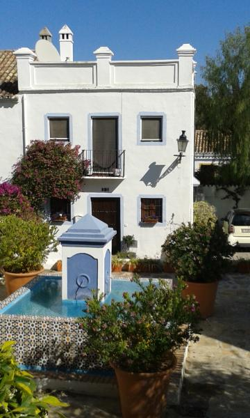 Front of Property looks onto pretty fountain area with lemon trees