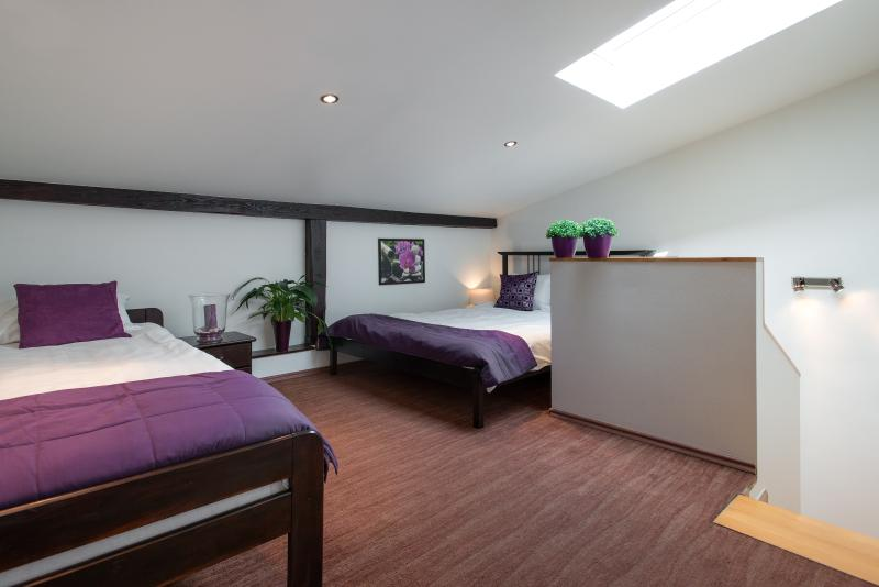 Bedroom with a double and single bed