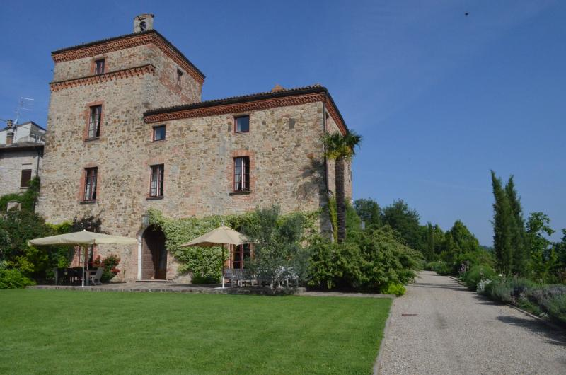 The main facade of the Tassara castle with the windows of some rooms for guests
