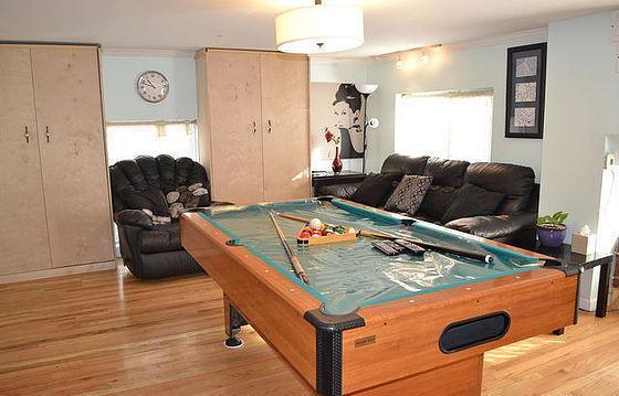 Living Room. Alternate view. Recliner Chair. Three Murphy Beds.