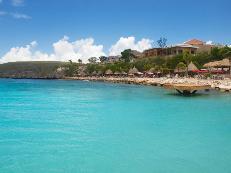 Crystal clear turquoise water at the beach of  Coral Estate
