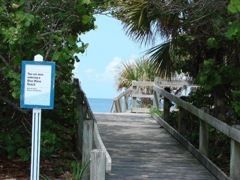 A blue water beach entrance to the Gulf of Mexico.