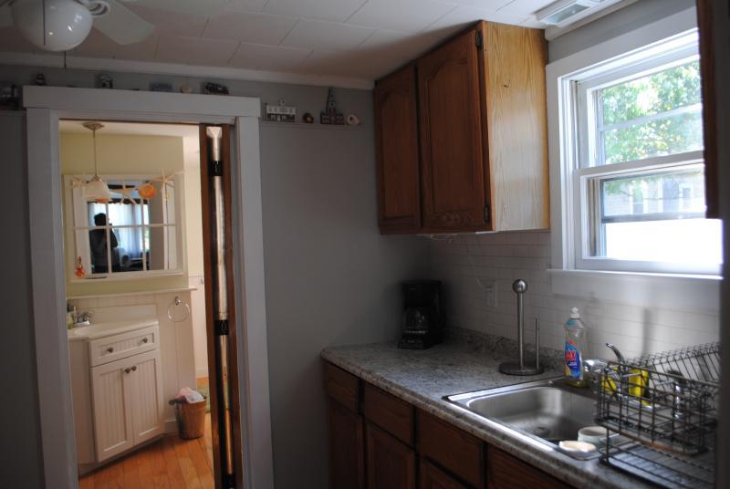 Kitchen looking into bathroom