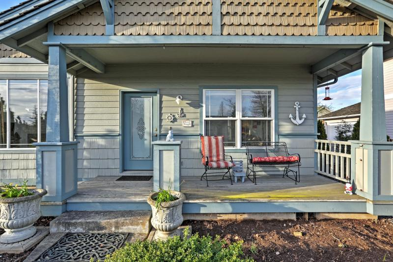 Sip your morning coffee on the nautically themed front porch!