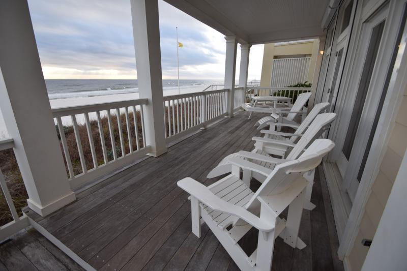 Gulf front deck directly at the top of the beach dunes with room to relax and have meals!