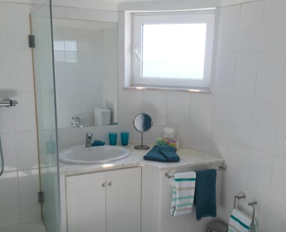 Bathroom connected to the master bedroom with shower, bidé, wc and a stunning view over the beach.