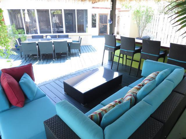 Cabana lounge, bar seating and dining table. Seating for 10 outdoor dining.