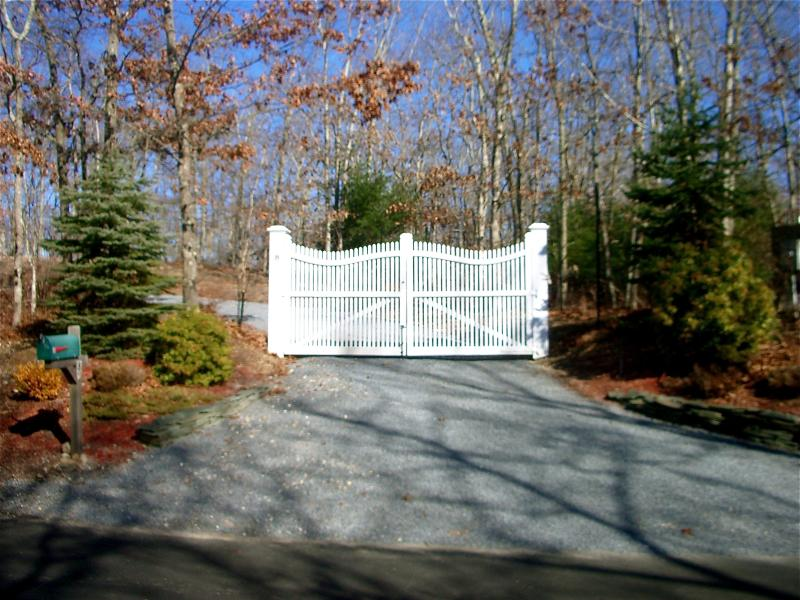 Entry gate with winding driveway.