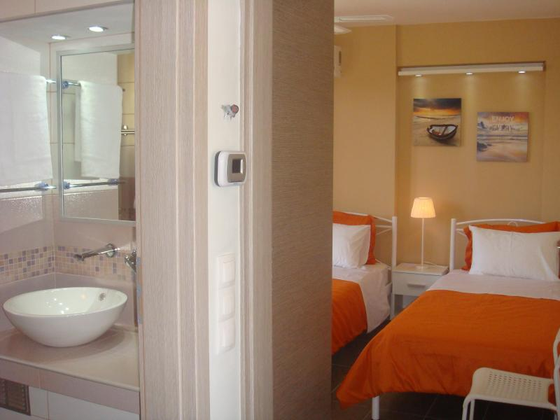 Bathroom and second bedroom.